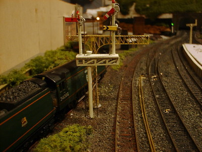 Old 'cast alloy' signal gantry with mechanical semaphore signals. New brass gantry and point rodding going in..